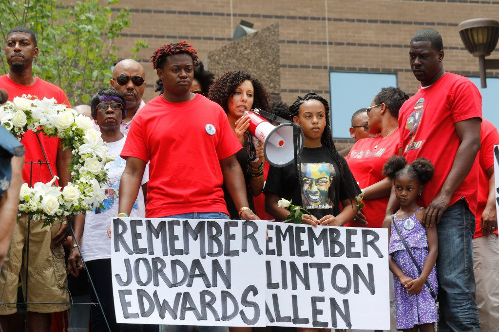 Sara Mokuria (center, with bullhorn) led a May 2017 rally on the steps of Dallas' Frank Crowley Courts Building with family members of Jordan Edwards, the 15-year-old shot and killed by a Balch Springs police officer.