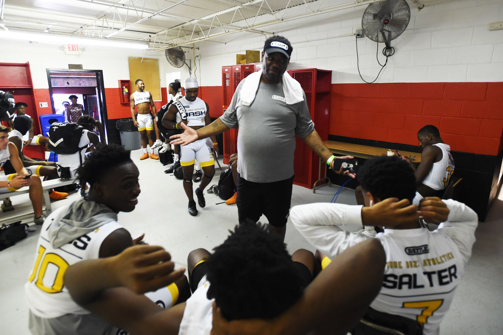 True Buzz coach Carlos Word talks to his players in the locker room prior to the Pylon 7v7 National Championship event held at Woodward Academy in Atlanta, Georgia, on May 26, 2019.