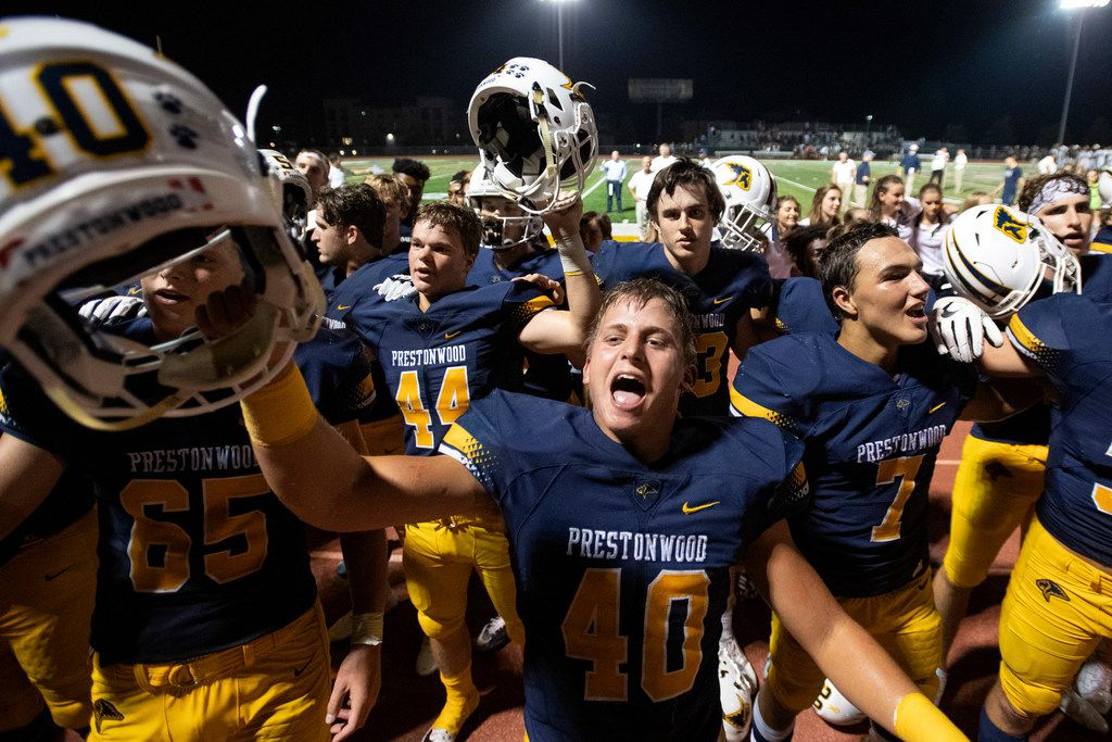 Plano Prestonwood Christian senior linebacker Walker Lunsford (40) and junior defensive back Randell Holmes (7) celebrate their 37-17 victory over Fort Worth All Saints in a high school football game on Friday, October 4, 2019 at Lions Stadium Plano, Texas. (Jeffrey McWhorter/Special Contributor)