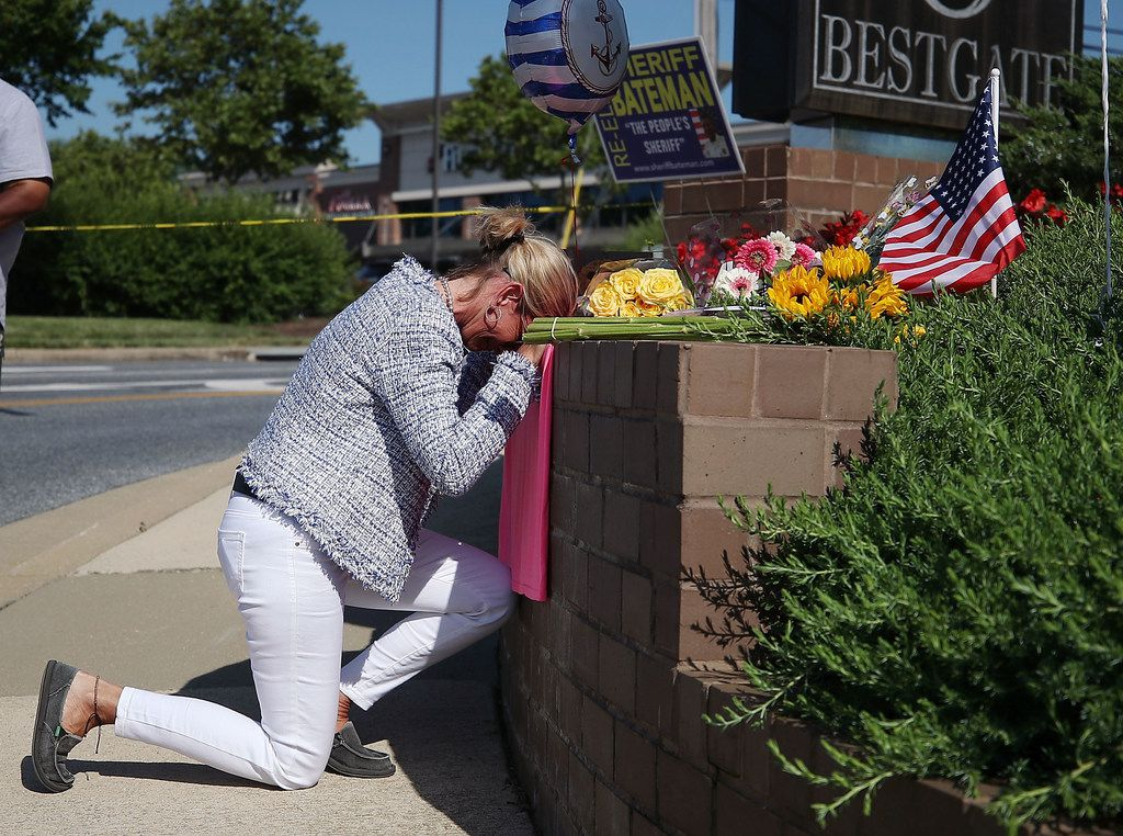Lynne Griffin pays her respects at a makeshift memorial near the Capital Gazette Communications building,  where five people were killed by a gunman on on June 29, 2018 in Annapolis, Md. Griffin was a journalism student of John McNamara, one of the journalists killed.