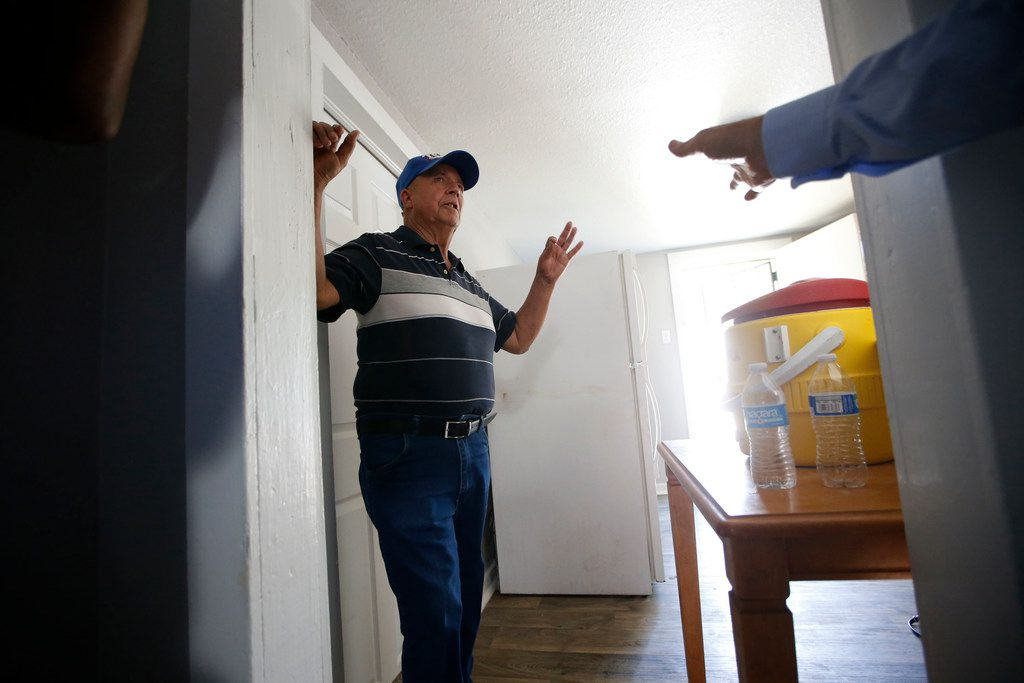 Julian Campos gives a tour of his home after a press conference announcing a federal lawsuit against HMK in Dallas on May 30. Legal Aid of Northwest Texas and Texas Legal Service center are filing a federal lawsuit  on behalf of West Dallas residents exposing reverse redlining.