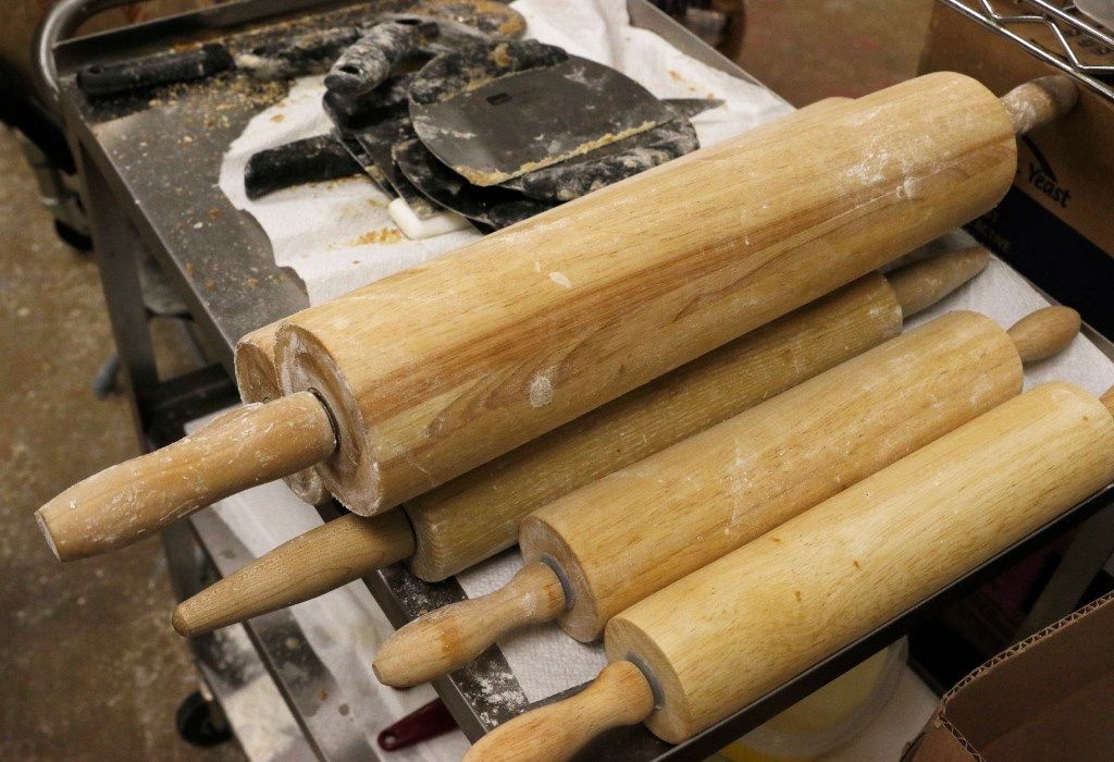 Baking rolling pins are used to make cinnamon rolls at RoRo's Baking Company.