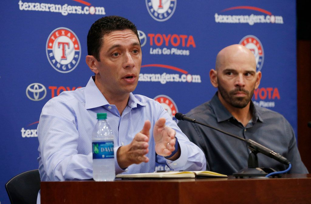 Texas Rangers general manager Jon Daniels, left, has plenty on his plate this offseason. Manager Chris Woodward, right, will be asked to make it all work on the field.