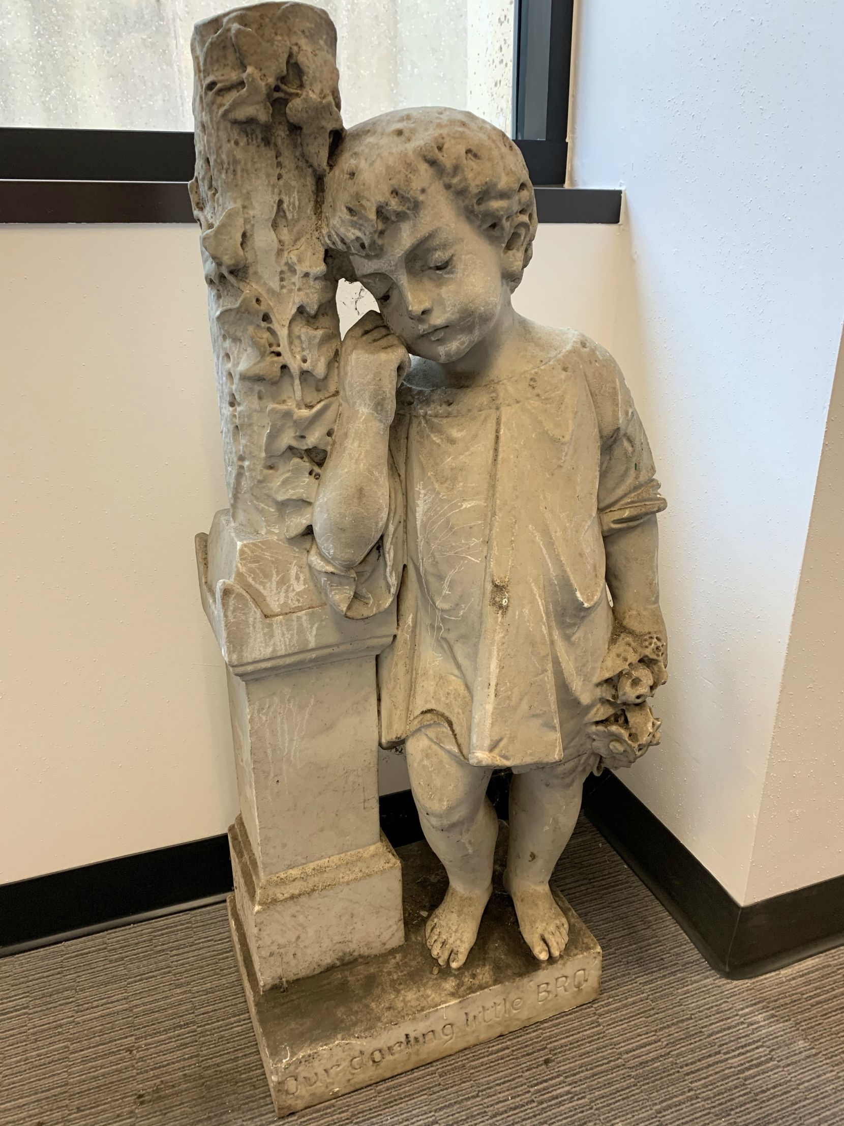 """This limestone grave marker was among the items kept in the Oakland Cemetery archives. It's unclear for whom this was made. At the bottom the inscription reads. """"Our darling little BRO."""""""