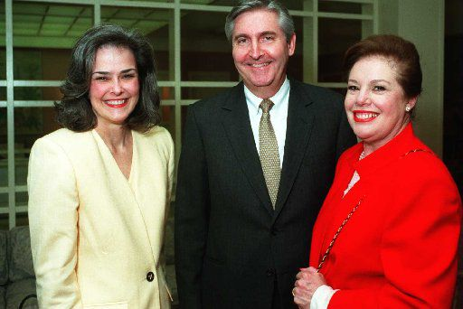 From left: Cyndi Bassel, Kern Wildenthal and  Patti Brown at the Crystal Charity Ball check presentation at Dallas  Country Club in 1996.