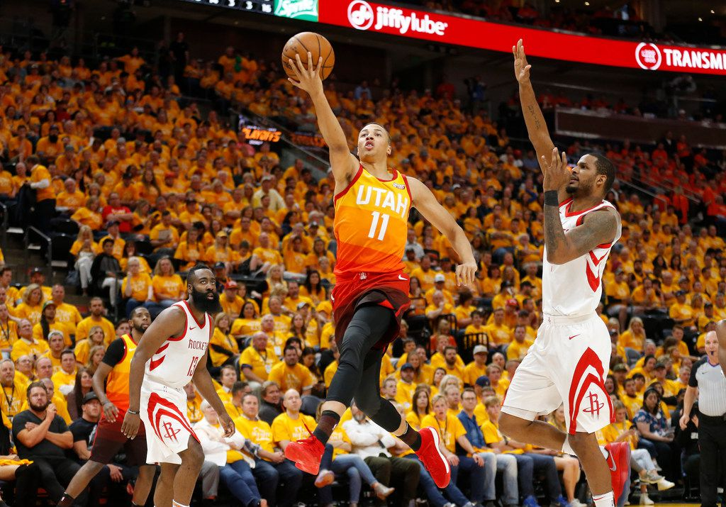 Utah Jazz guard Dante Exum (11) lays the ball up as Houston Rockets forward Trevor Ariza, right, defends during the second half in Game 3 of an NBA basketball second-round playoff series Friday, May 4, 2018, in Salt Lake City. The Rockets won 113-92. (AP Photo/Rick Bowmer)
