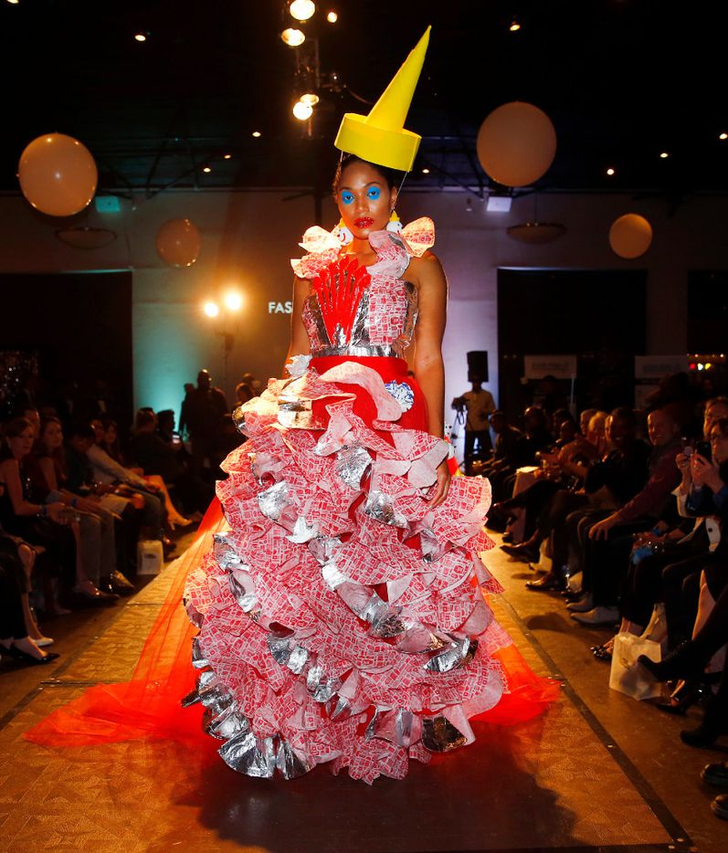 Model Ty Cain shows off her Jack in the Box dress with items found at the fast-food restaurant. The dress was designed by Roxanna and Luisa Santana under the label Fashionmarilu for the Food in Fashion event at 3015 in the Trinity Groves area of Dallas on February 15, 2017.