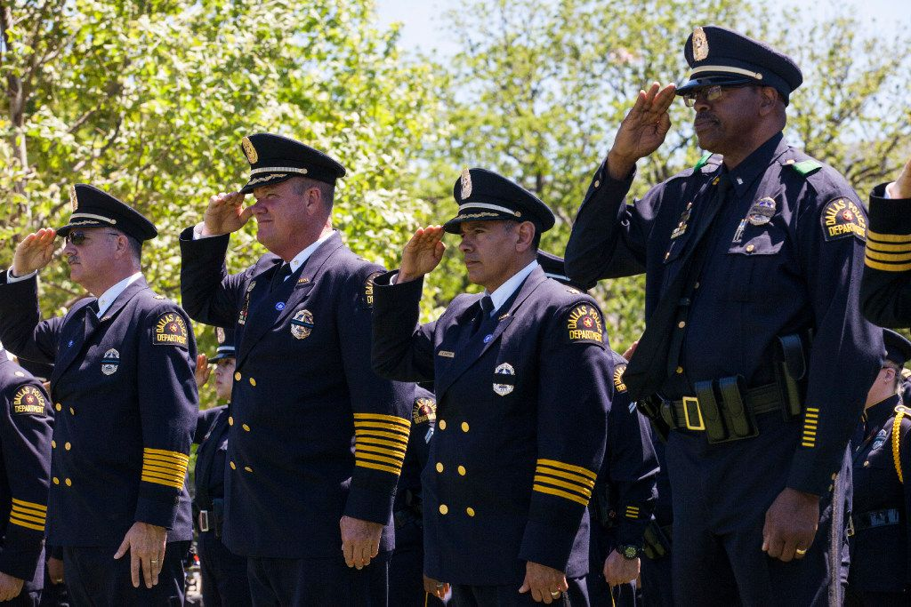 Dallas, Texas law enforcement officers salute as names of Texans are read during a roll call of fallen officers during the 36th Annual National Peace Officers' Memorial Service on the West Lawn of The U.S. Capitol Building Monday, May 15, 2017 in Washington, D.C.  The service, which takes place every year on May 15, honored federal, state, and local officers killed or disabled in the line of duty.  (Zach Gibson/Special Contributor)