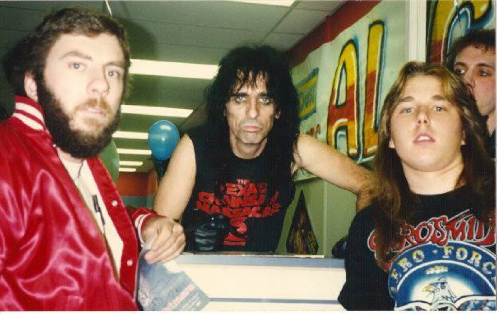 In 1987, when he was a teenager in San Antonio, Chris Penn, in the Aerosmith shirt, met Alice Cooper at a Sound Warehouse grand opening.
