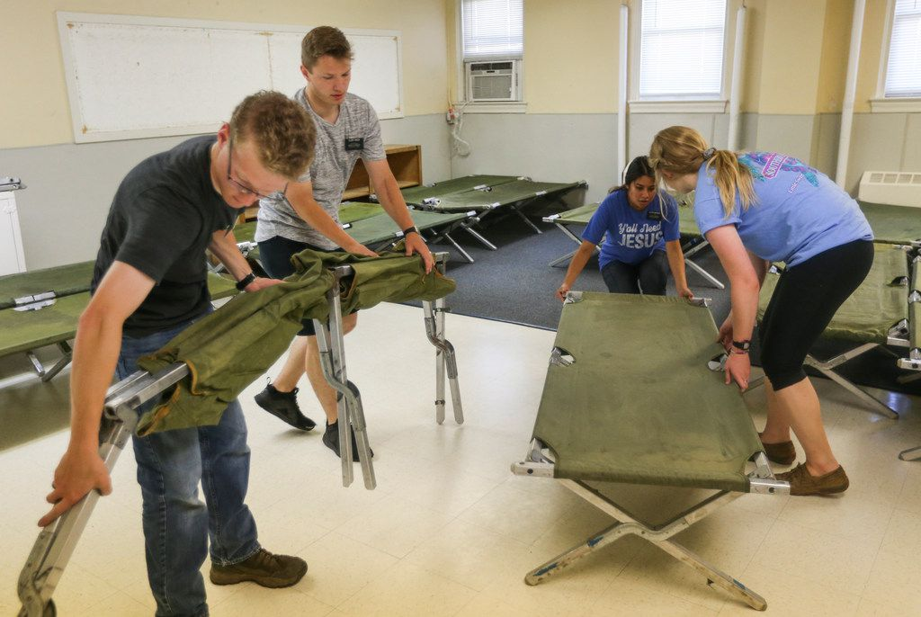 Volunteers from the Church of Jesus Christ of Latter-day Saints set up cots at Oak Lawn United Methodist Church on Thursday.