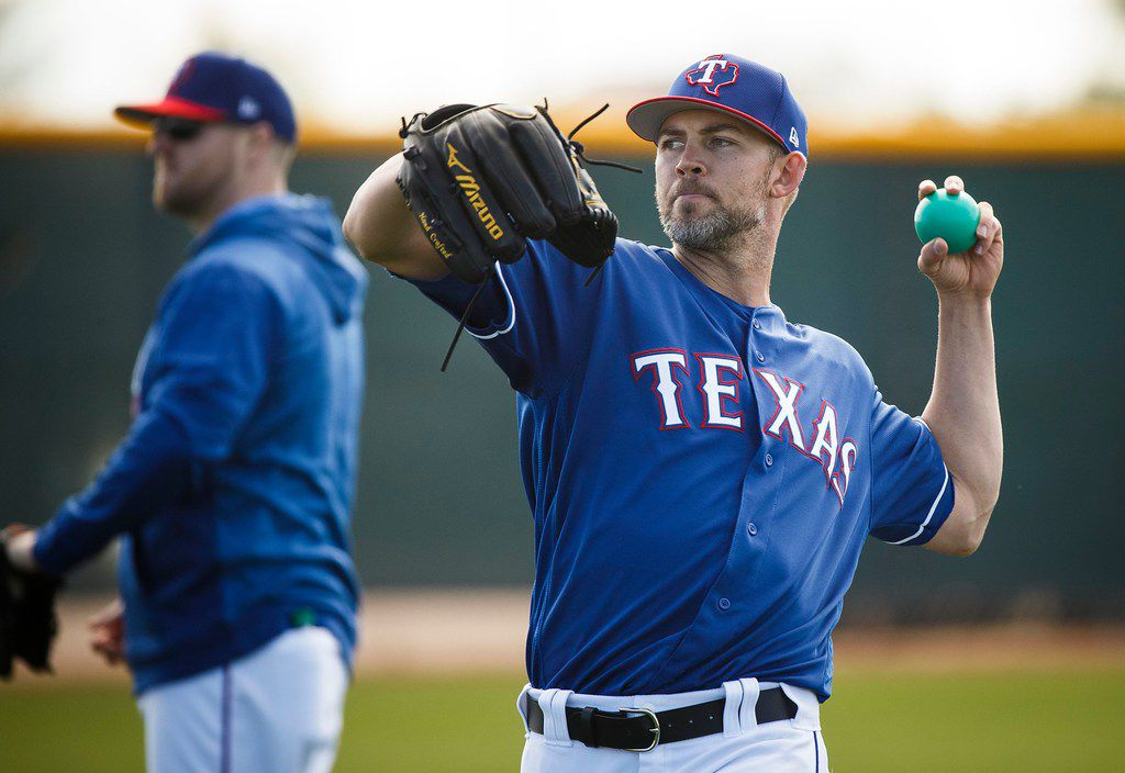 Texas Rangers pitcher Mike Minor tosses a heavy ball during a spring training workout at the team's training facility on Saturday, Feb. 16, 2019, in Surprise, Ariz.. (Smiley N. Pool/The Dallas Morning News)