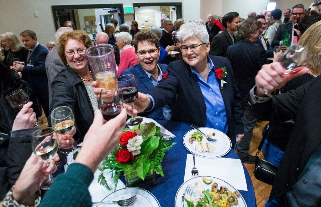 Linda and Beth Gerwe (center) toast after a mass celebration and blessing of marriage for 15 same-sex couples on Saturday, Jan. 19, 2019, at Episcopal Church of the Transfiguration in Far North Dallas.
