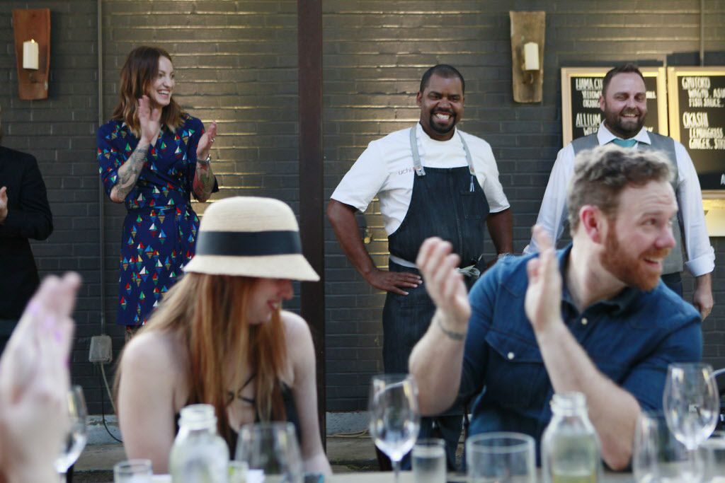 Uchi restaurant general manager Bryan LaFontaine, far right, standing, introduces chef de cuisine Nilton Borges Jr., center, and bartender colleague Emily Perkins, of Remy Cointreau USA, far left, during a preview of Uchi's food at a temporary pop-up location.