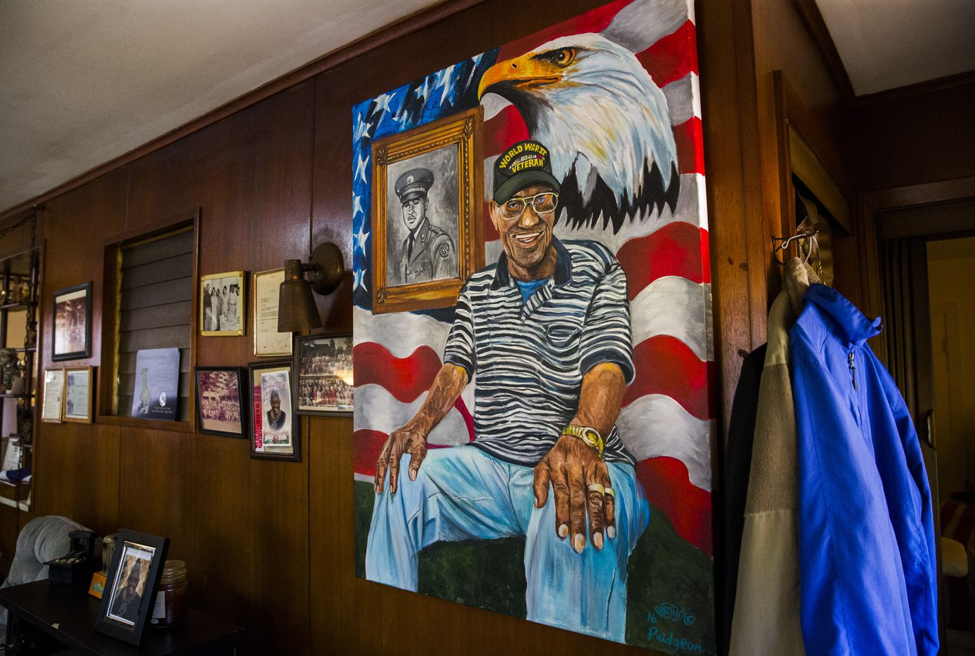 A painted portrait of Richard Overton is displayed with photographs and other mementos in his home  in Austin.