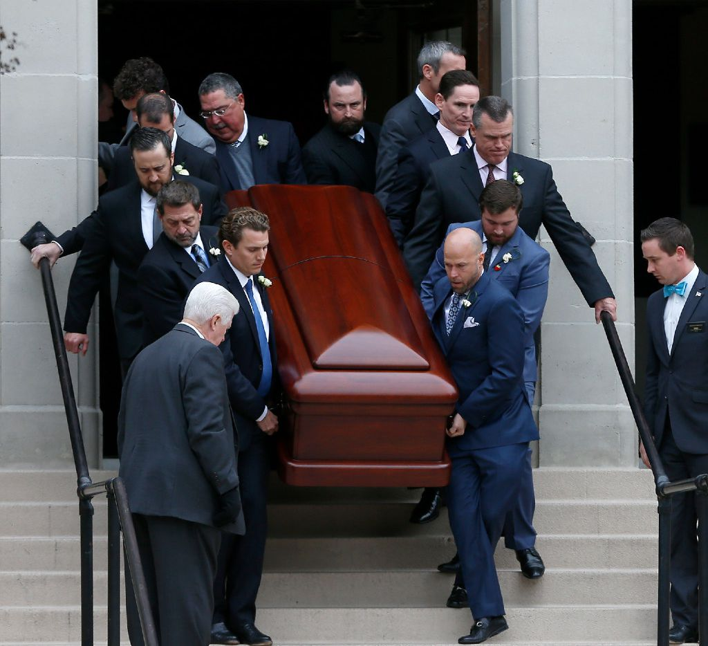Pallbearers carried the casket of Brian Loncar down the front steps of the Munger Place Church following his funeral in Dallas on Friday. (Jae S. Lee/Staff Photographer)