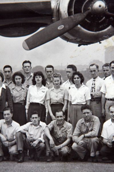 As a young woman, Betty Franzen, worked on B-24 bombers at the Northwest Airlines Saint Paul Modification Center in Minneapolis, Minnesota. Betty is shown here in this 1944 photograph, second row, second woman from the right, with the man who became her husband, Evert Franzen, directly in front of her.
