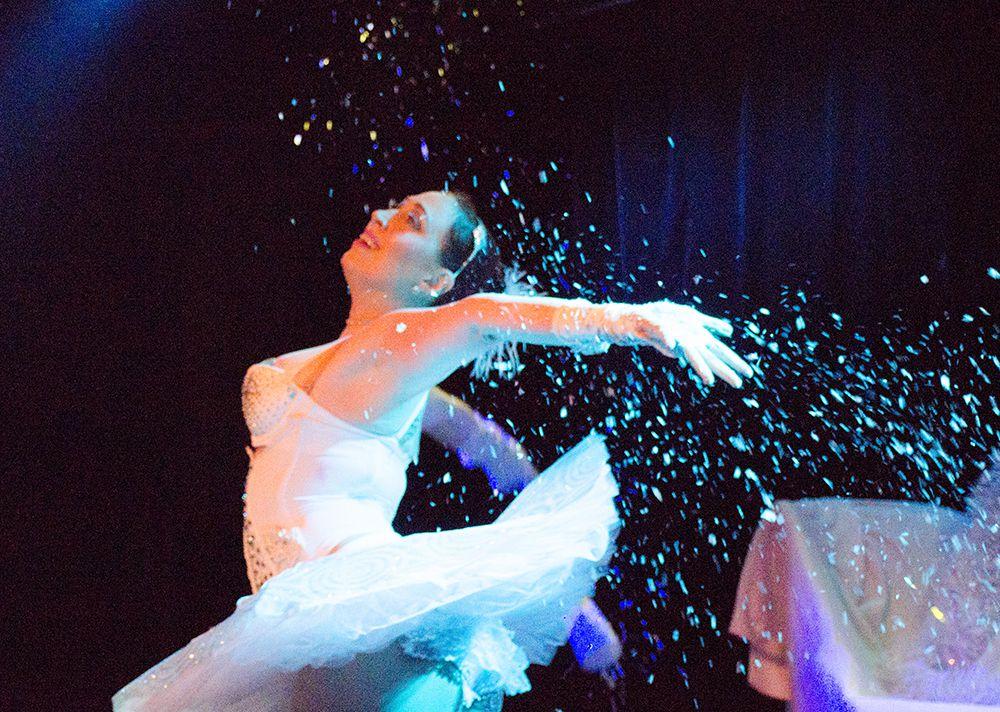 Snow Queen Ella Ardour dances in glitter at the 5th annual Nearly Naked Nutcracker.