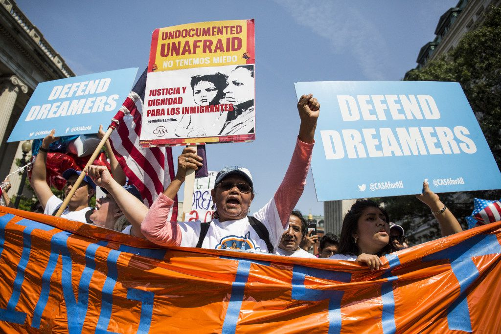 WASHINGTON, DC - SEPTEMBER 5:  Demonstrators march during a demonstration in response to the Trump Administration's announcement that it would end the Deferred Action for Childhood Arrivals (DACA) program on September 5, 2017 in Washington, DC.  DACA, an immigration policy passed by former President Barack Obama, allows certain undocumented immigrants who arrived in the United States as minors to receive renewable two-year deferred action from deportation. (Photo by Zach Gibson/Getty Images)