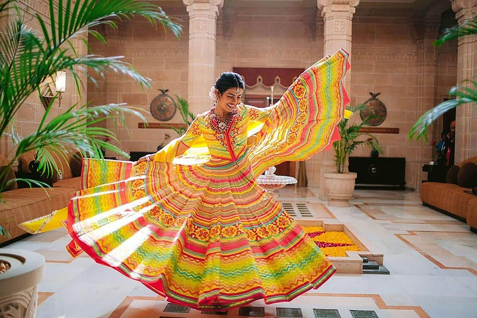 This handout photo released by Raindrop Media shows Bollywood actress Priyanka Chopra dancing during her wedding celebration with American singer Nick Jonas at Umaid Bhawan palace in Jodhpur.