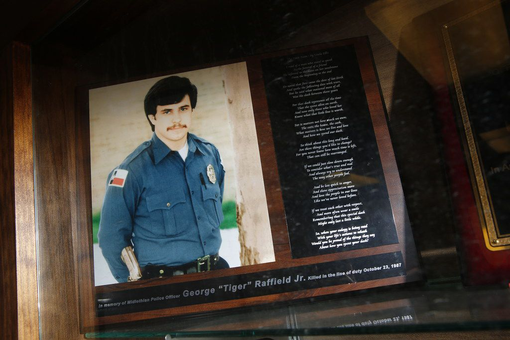 "A plaque to remember George Raffield Jr. is in the lobby of the Midlothian Police Department. Raffield was killed in the line of duty on Oct. 23, 1987. The plaque includes a poem called ""The Dash"" by Linda Ellis."
