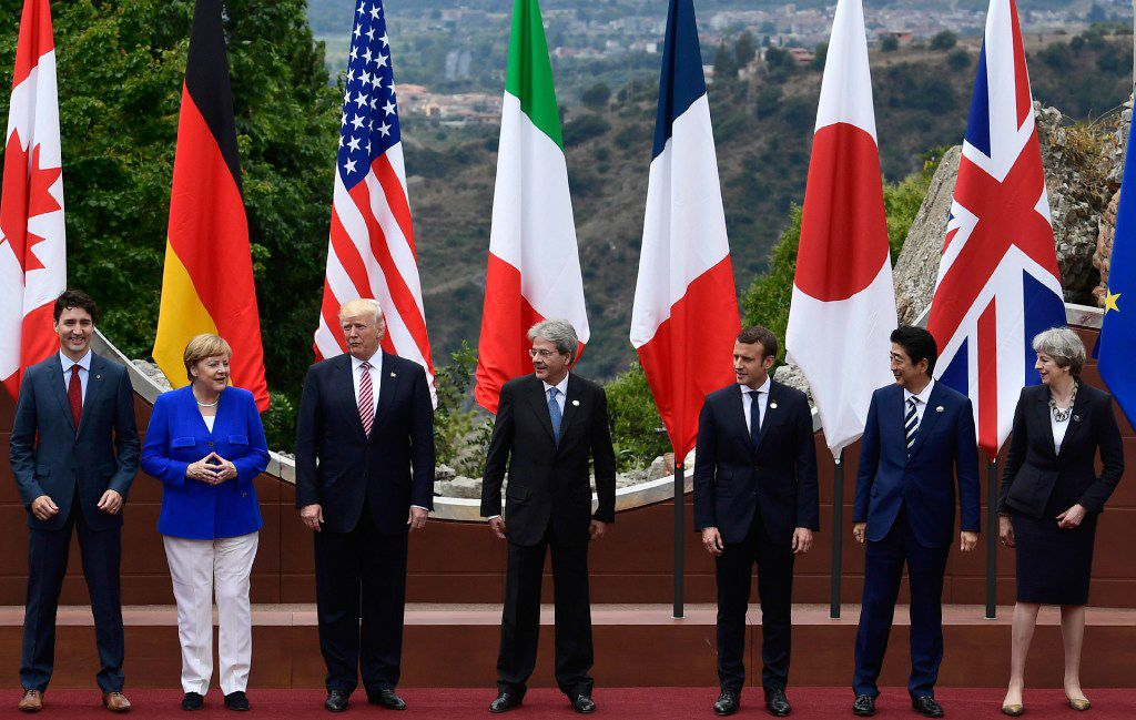 TOPSHOT - From left : Canadian Prime Minister Justin Trudeau, German Chancellor Angela Merkel, US President Donald Trump, Italian Prime Minister Paolo Gentiloni, French President Emmanuel Macron, Japanese Prime Minister Shinzo Abe, and Britain's Prime Minister Theresa May, pose for a family photo at the ancient Greek Theatre of Taormina during the Heads of State and of Government G7 summit, on May 26, 2017 in Sicily. The leaders of Britain, Canada, France, Germany, Japan, the US and Italy will be joined by representatives of the European Union and the International Monetary Fund (IMF) as well as teams from Ethiopia, Kenya, Niger, Nigeria and Tunisia during the summit from May 26 to 27, 2017. / AFP PHOTO / Miguel MEDINAMIGUEL MEDINA/AFP/Getty Images