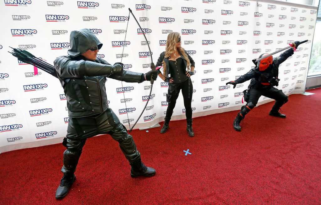 People wearing a costume pose for a photograph at the Cosplay Red Carpet during the FAN EXPO Dallas at Kay Bailey Hutchison Convention Center in Dallas, Saturday, April 7, 2018. (Jae S. Lee/The Dallas Morning News)