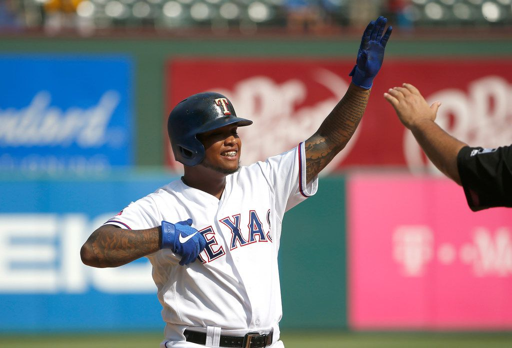 ARLINGTON, TX - AUGUST 4: Willie Calhoun #5 of the Texas Rangers celebrates after hitting a three run triple against the Detroit Tigers during the seventh inning  at Globe Life Park in Arlington on August 4, 2019 in Arlington, Texas. The Rangers won 9-4. (Photo by Ron Jenkins/Getty Images)