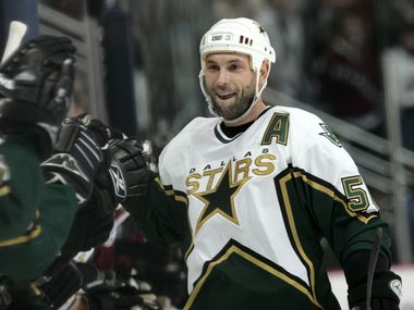 FILE - Dallas Stars defenseman Sergei Zubov of Russia celebrates with teammates after scoring a goal in the shootout in the Stars' 3-2 victory over the Colorado Avalanche in an NHL hockey game in Denver, Thursday, jan. 26, 2006. (AP Photo/David Zalubowski)