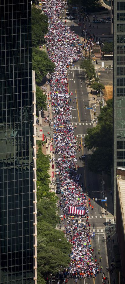 Demonstrators fill Ross Avenue during the 2017 Dallas Mega March on Sunday, April 9, 2017. Thousands of people marched through downtown Sunday afternoon to support immigrants' rights.