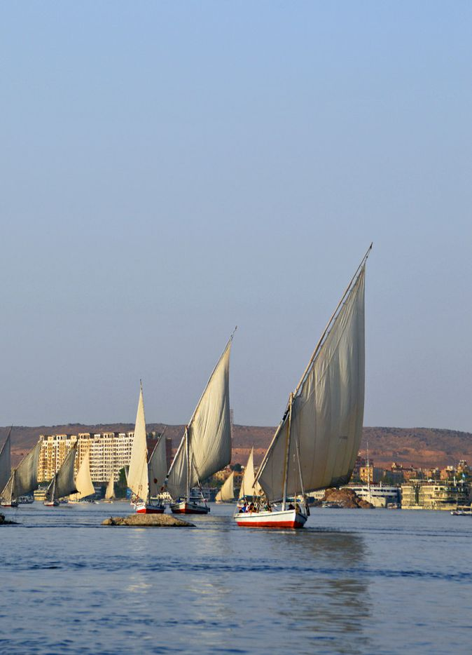 Felucca excursions on the Nile River near Aswan are popular with tourists.