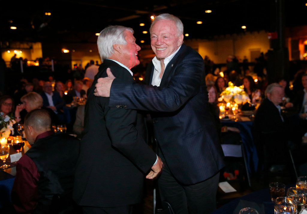 Dallas Cowboys owner Jerry Jones (right) and his former Super Bowl-winning coach Jimmy Johnson shake hands and hug following the 25th anniversary of the Dallas Cowboys Super Bowl XXVII at Gilley's in Dallas, The event was hosted by Troy Aikman and United Way of Metropolitan of Dallas. The evening featured appearances by Cowboys legends, a conversation with head coach Jimmy Johnson and other members of the 1992 coaching staff, and a special celebration honoring Jerry Jones for his election to the Pro Football Hall of Fame. (Tom Fox/The Dallas Morning News)
