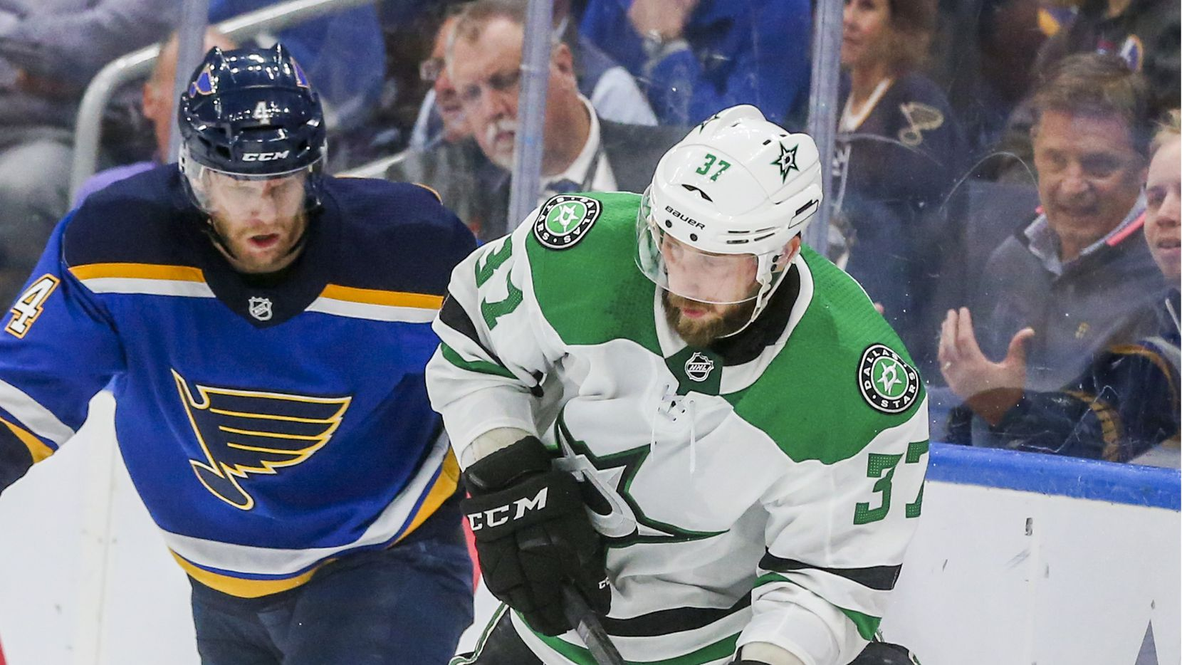 Dallas Stars center Justin Dowling (37) looks to make a pass as he is defended by St. Louis Blues defenseman Carl Gunnarsson (4) during the second period of game 5 of an NHL second round playoff series at Enterprise Center in St. Louis, Missouri on Friday, May 3, 2019.