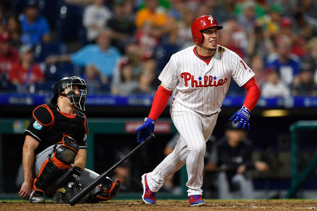 Philadelphia Phillies' Asdrubal Cabrera, right, watches the ball after hitting a double off Miami Marlins' Drew Rucinski during the fifth inning of a baseball game, Saturday, Sept. 15, 2018, in Philadelphia. (AP Photo/Derik Hamilton) ORG XMIT: PADH109