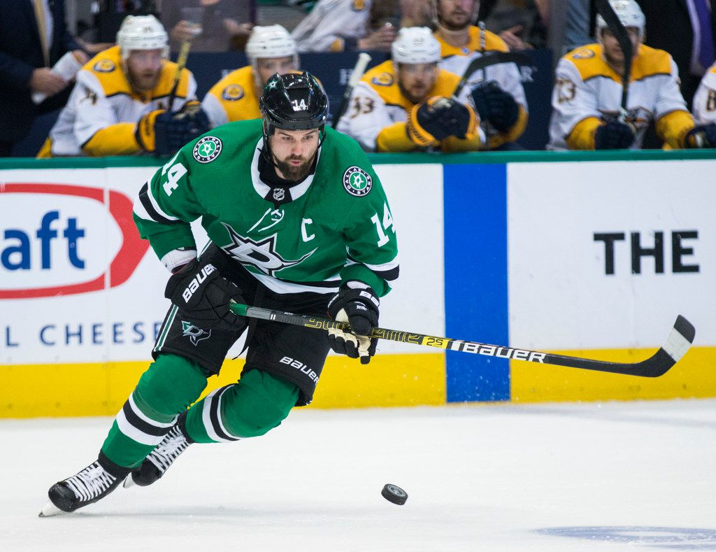 Dallas Stars left wing Jamie Benn (14) takes the puck during the first period of Game 6 of the first round of Stanley Cup Playoffs between the Dallas Stars and the Nashville Predators on Monday, April 22, 2019 at American Airlines Center in Dallas. (Ashley Landis/The Dallas Morning News)