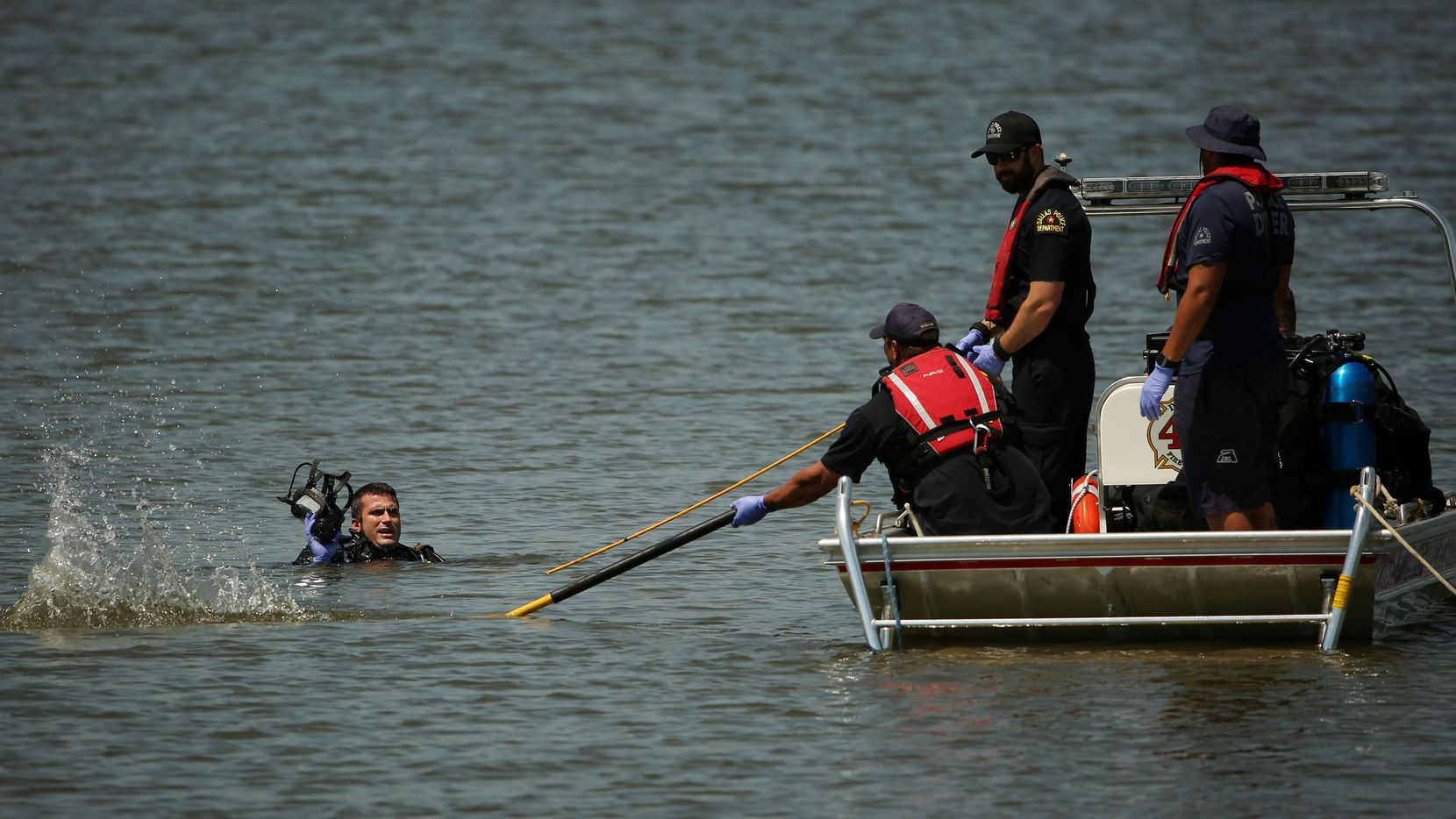 A Dallas Fire-Rescue crew and a Dallas police diver search for a man after he entered the water Thursday afternoon at William Blair Jr. Park and didn't resurface.