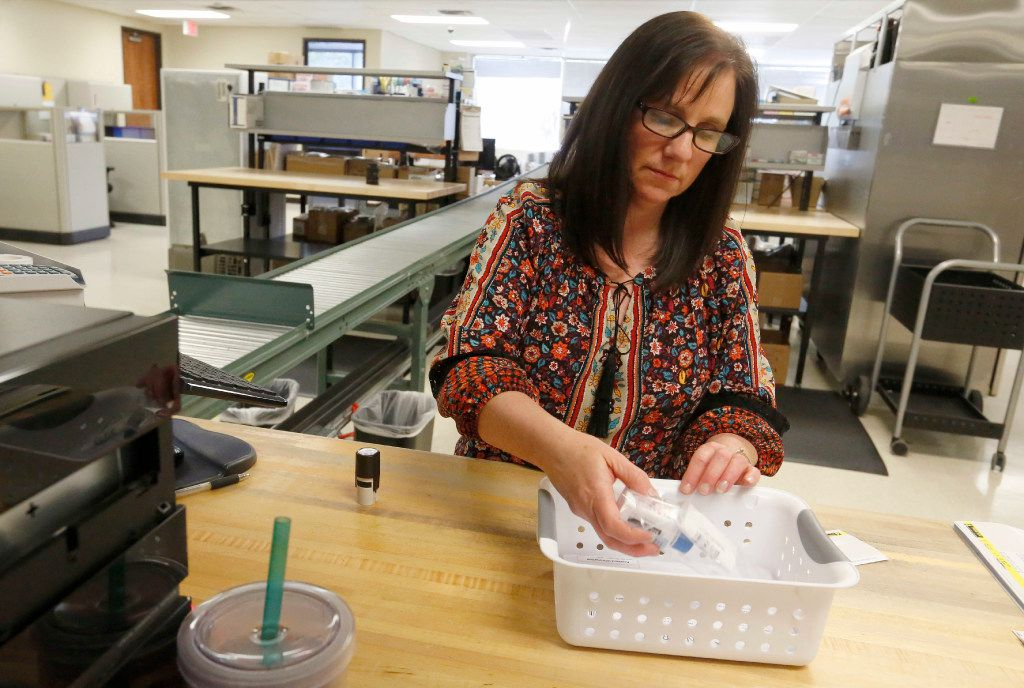 Pharmacist Diane Damrau fills an order at Senderra Specialty Pharmacy in Richardson.