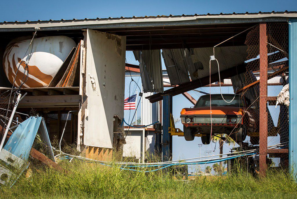 A car still sits on a lift in what remains of a commercial building that sustained heavy damage when Hurricane Harvey slammed into Port Aransas on the Texas Gulf Coast in August 2017.