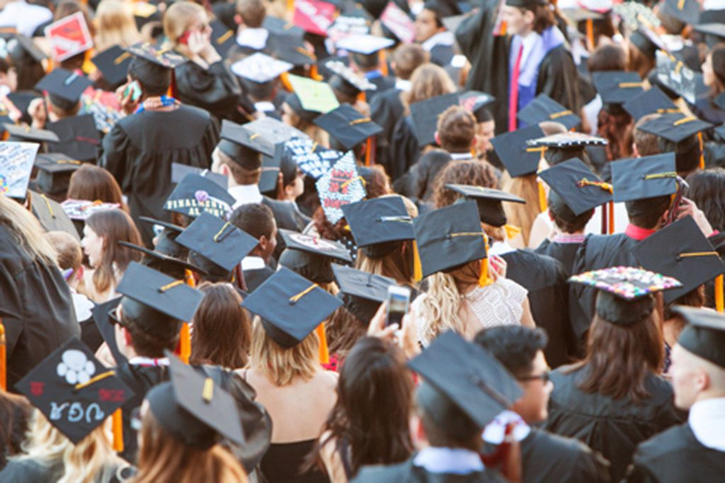 Graduates Wearing Mortarboards Gather For Graduation Activities (Dreamstime/TNS)