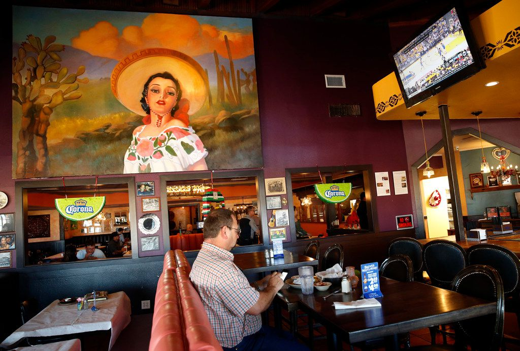 A large painting by Peggy Jones was moved from the original El Chico in the Bishop Arts district to the new El Corazon Vintage Tex-Mex in McKinney. She is wearing the sequined 'China Poblana' dress owned by Julia Cuellar, wife of El Chico co-founder Frank Cuellar. The dress is now part of a Smithsonian exhibit.
