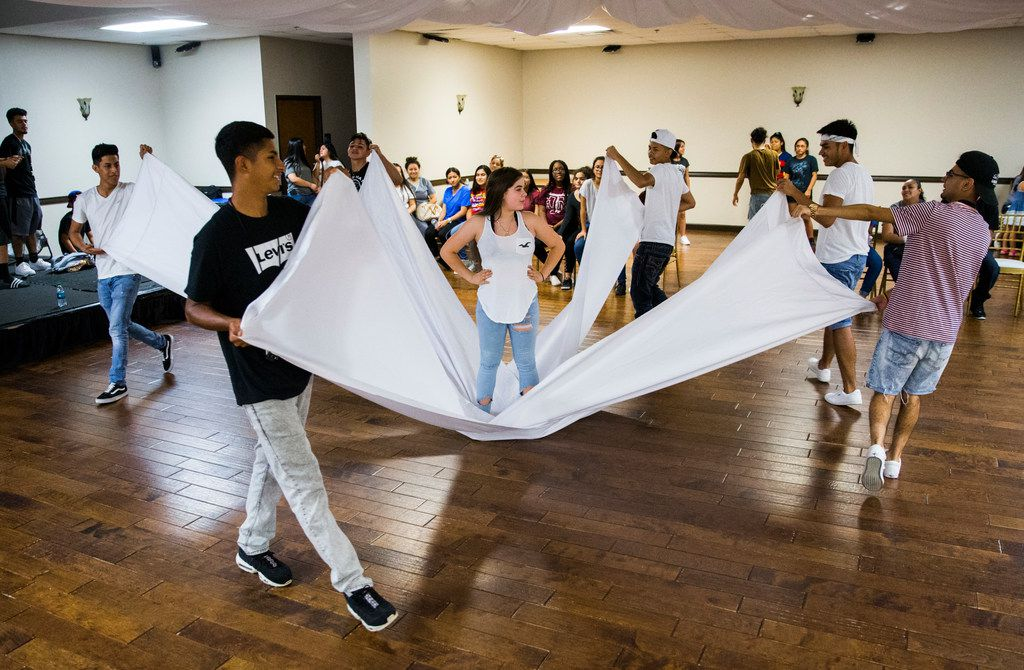 The Latin Boyz Cadets rehearse with Katia Gonzalez, 14 (center) for her quinceañera.