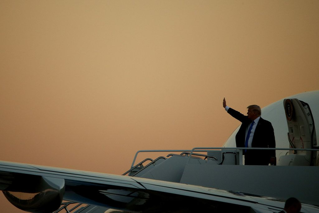 President Donald Trump boards Air Force One before departing Love Field after a visit that included a stop at the Belo Mansion and a hurricane recovery briefing in Dallas Wednesday October 25, 2017. President Trump participated in a hurricane recovery briefing, a Republican National Committee roundtable and gave remarks at a reception. (Andy Jacobsohn/The Dallas Morning News)
