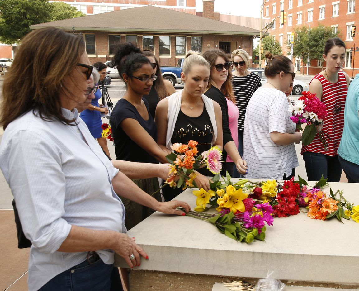 The memorial began when a group of unidentified women placed flowers at Jack Evans Police Headquarters in Dallas on Friday July 8.