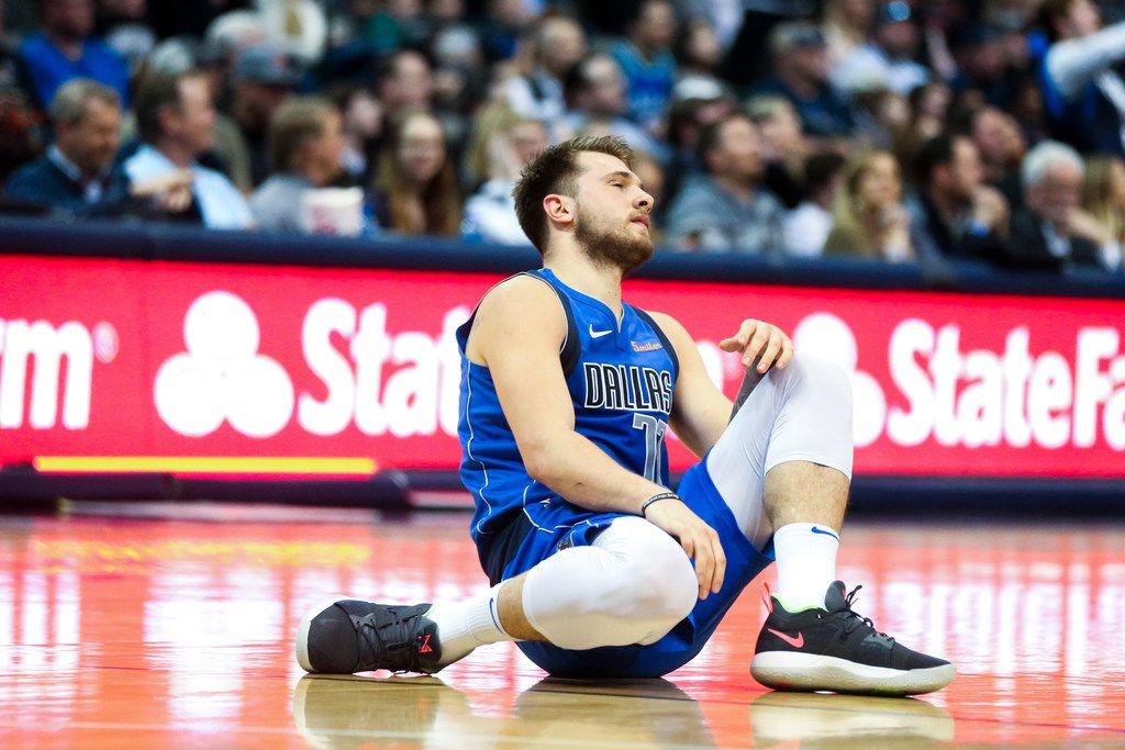 Dallas Mavericks forward Luka Doncic (77) collapse to the floor after getting a ball stolen before the half during an NBA basketball game at American Airlines Center in Dallas on Tuesday, March 12, 2019.  (Shaban Athuman/The Dallas Morning News)