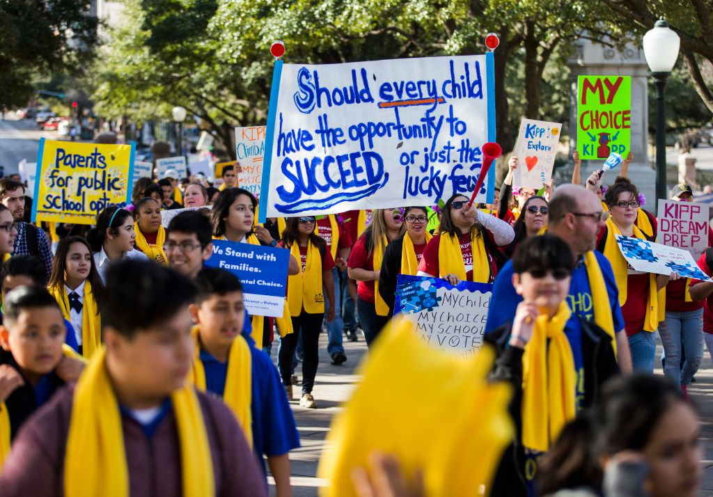 Demonstrators march on the Texas capitol grounds to show their support for expanding school choice options during National School Choice Week on Tuesday, January 24, 2017 at the Texas state capitol in Austin. (Ashley Landis/The Dallas Morning News)