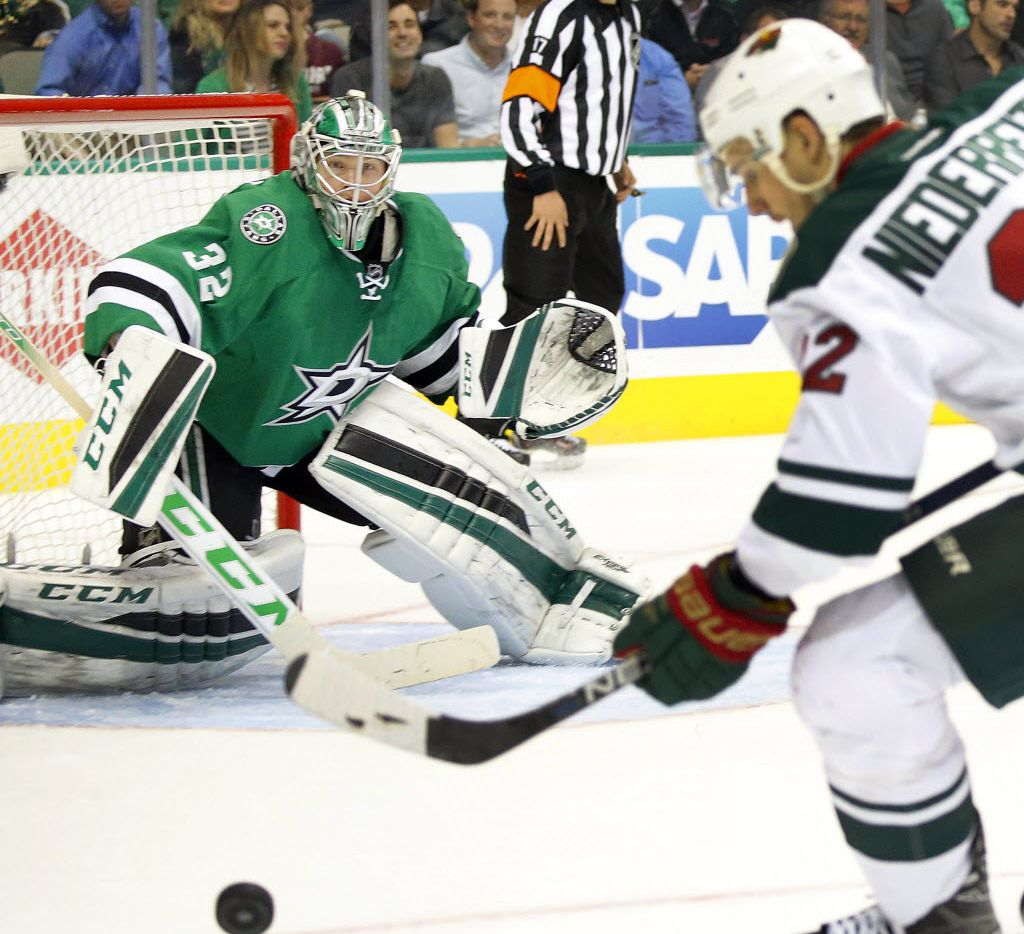 Dallas Stars goalie Kari Lehtonen (32) watches as Minnesota Wild right wing Nino Niederreiter (22) gathers the puck in the second period of their Game 1 playoff at the American Airlines Center in Dallas,Thursday, April 14, 2016. (Tom Fox/The Dallas Morning News)
