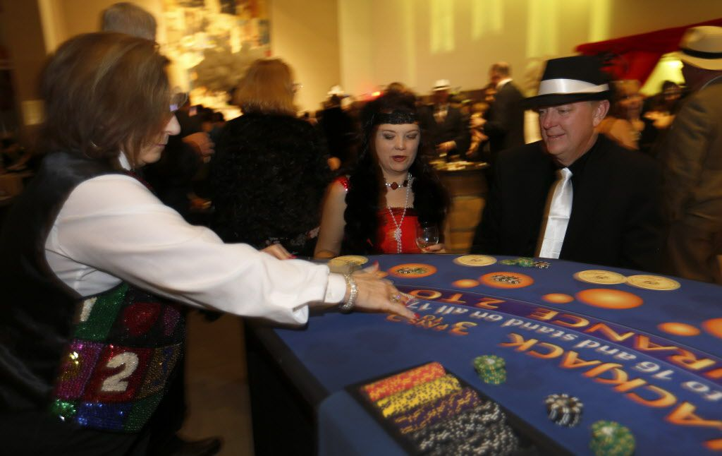 Angela and Lance Mandell play blackjack during the DMA Speakeasy event in celebration of Shaken Stirred Styled: The Art of the Cocktail at Dallas Museum of Art in Dallas, Saturday, Feb. 4, 2017.