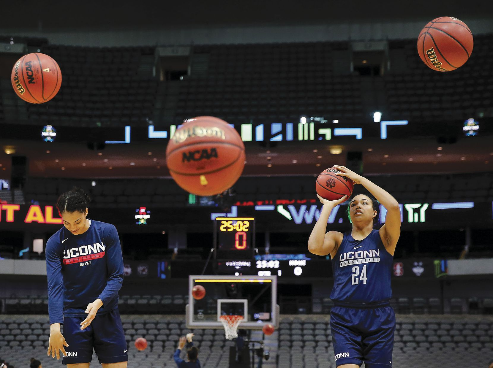 Connecticut Huskies guard/forward Napheesa Collier (right) and teammate Gabby Williams shoot baskets during practice for their NCAA Women's Final Four semifinal game at American Airlines Center in Dallas.