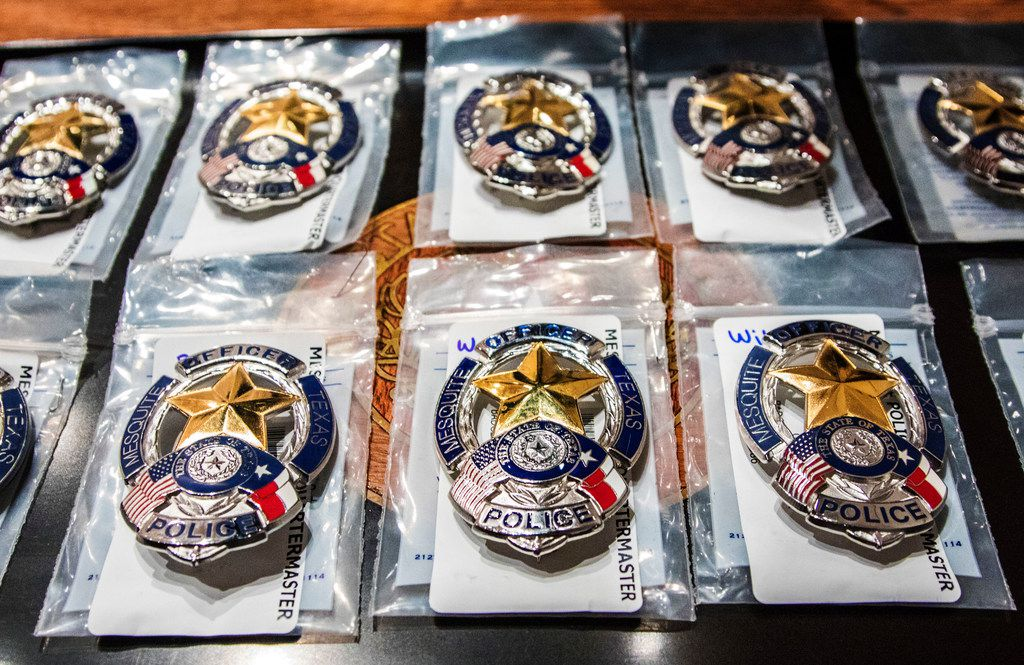 Police badges before getting pinned on uniforms during graduation from Mesquite police academy at Mesquite Arts Center on Oct. 5, 2018. The Mesquite Police Department graduated 10 officers from the academy.