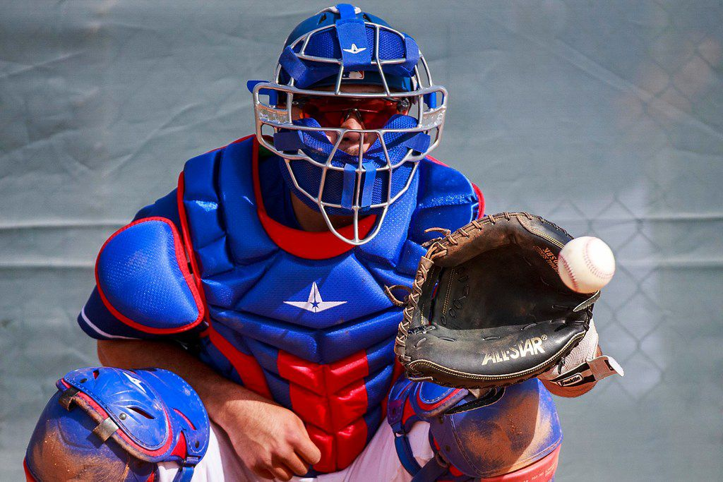 Texas Rangers catcher/infielder Isiah Kiner-Falefa catches a bullpen session during a spring training workout at the team's training facility on Friday, Feb. 15, 2019, in Surprise, Ariz.. (Smiley N. Pool/The Dallas Morning News)