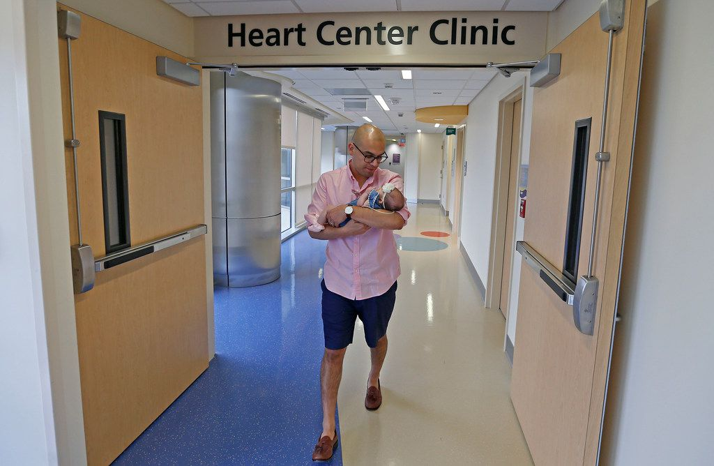 Dallas Independent School District Trustee Miguel Solis left the Heart Center Clinic with daughter Olivia Solis after she had her weight checked on the day they left Children's Medical Center in Dallas.